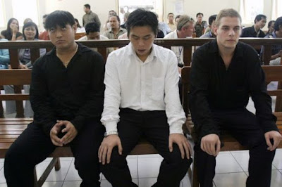 Tan Duc Thanh Nguyen, Si Yi Chen and Matthew Norman in Denpasar District Court.
