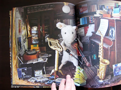 "Inside spread from the book 'Mouse Mansion: Sam and Julia"", showing a mouse playing the violin in a miniature music room."