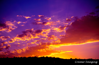 Cramer Imaging's professional quality nature cloudscape photograph of a colorful sunset lighting up clouds in Tetonia, Fremont, Idaho