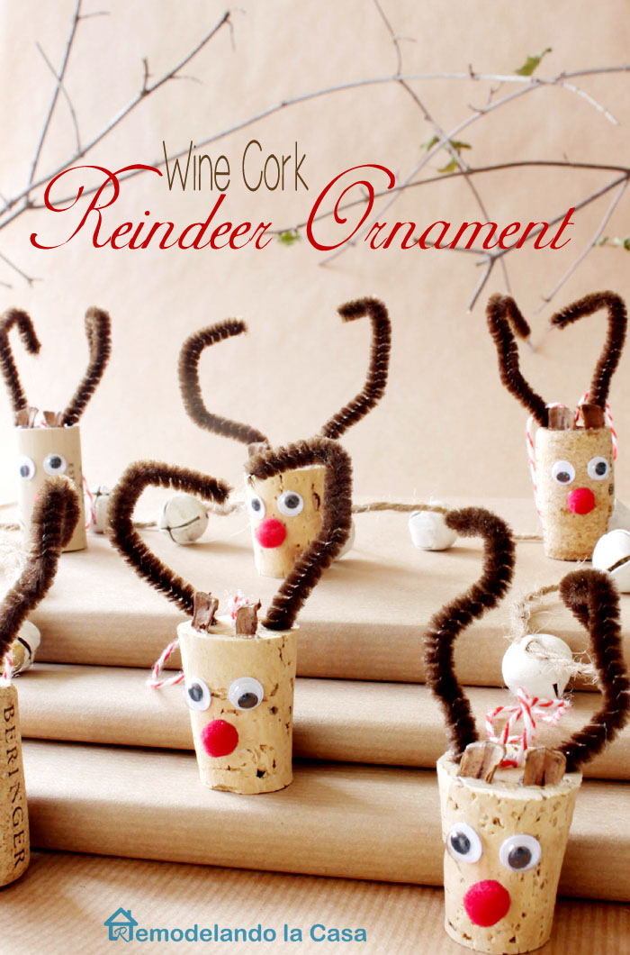 wine corks and pipe cleaners are set together to create a herd of reindeers