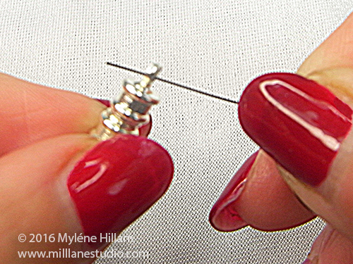 Slide a magnetic clasp onto the beading wire.
