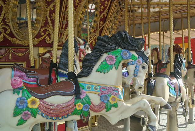 ride a carousel