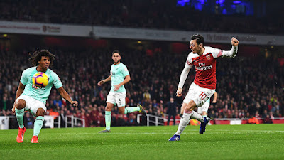 ozil wins goal of the month february