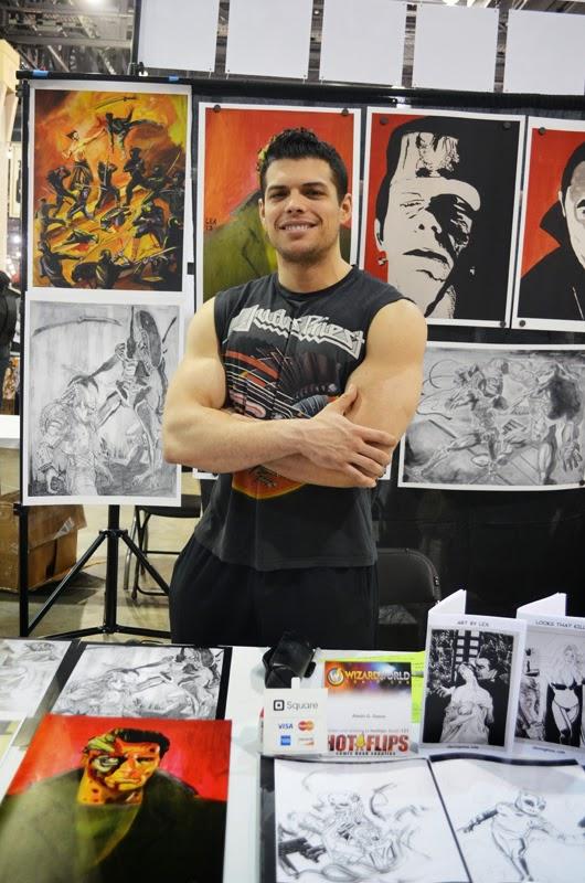 Artist Alexio Gressa poses for Kyle McMahon in front of his art in Philadelphia