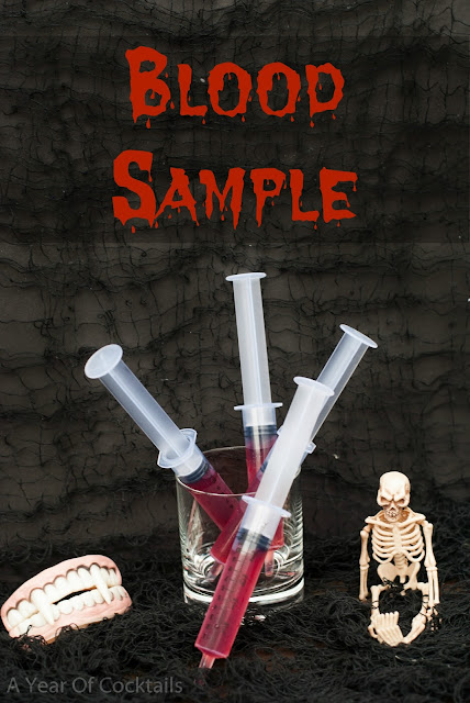 Halloween cocktails shots, blood sample, vanilla vodka, pomegranate juice, plastic syringe
