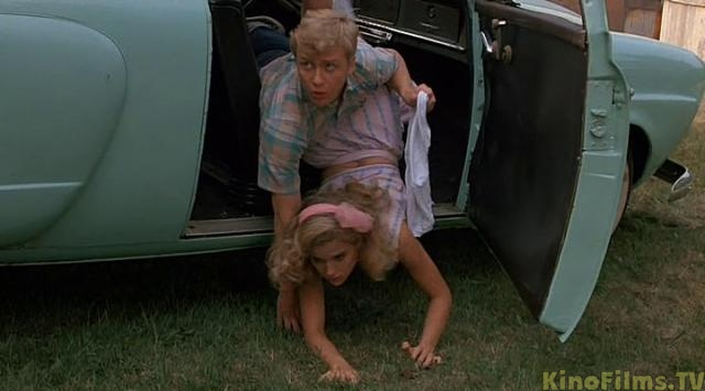 Mischief 1985 Kelly Preston and Doug McKeon actually falling out of the car movieloversreviews.filminspector.com