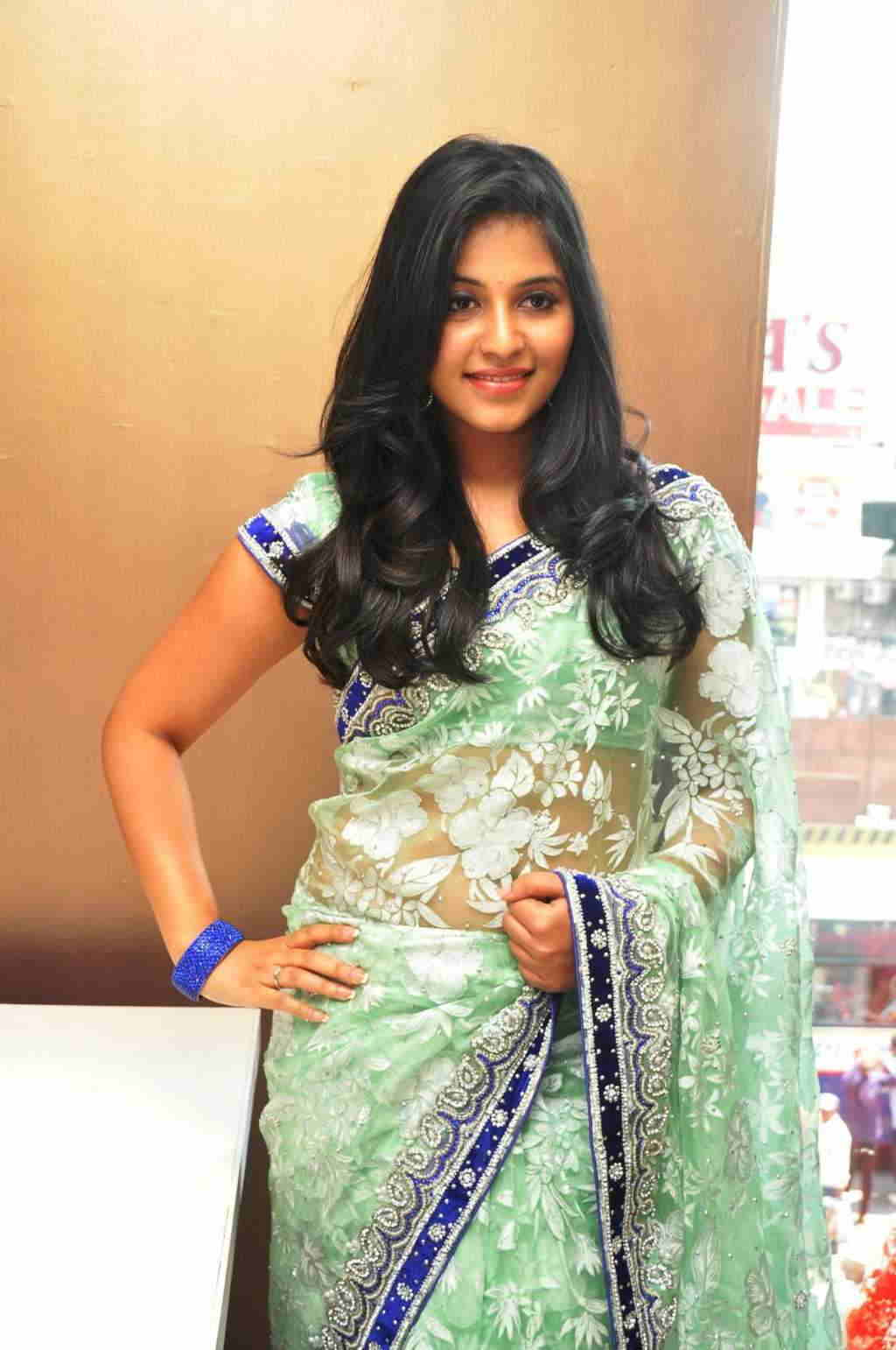 Beautiful Telugu Girl Anjali Long Hair Stills In Transparent Green Saree