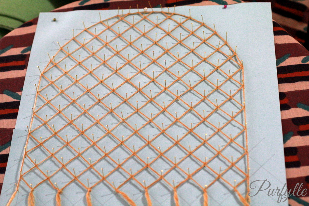 the lace project on the cushion waiting to set