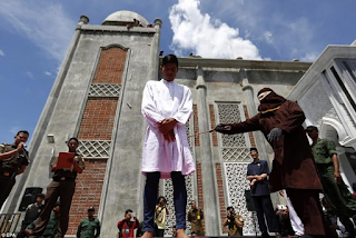 Man and woman flogged in Indonesia for breaking Sharia law