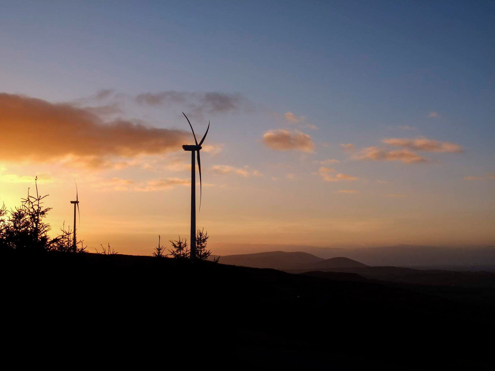 A mountain and windmill landscape at sunset in North County Cork.