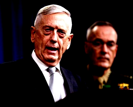 Defense Secretary Jim Mattis, joined by Joint Chiefs Chairman Gen. Joseph Dunford, speaks at the Pentagon, Friday, April 13, 2018, on the U.S. military response, along with France and Britain, in response to Syria's chemical weapon attack on April 7.