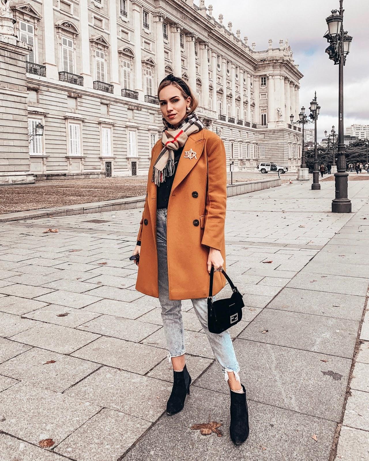 mustard coat blue jeans burberry scarf fendi baguette bag headband spring outfit