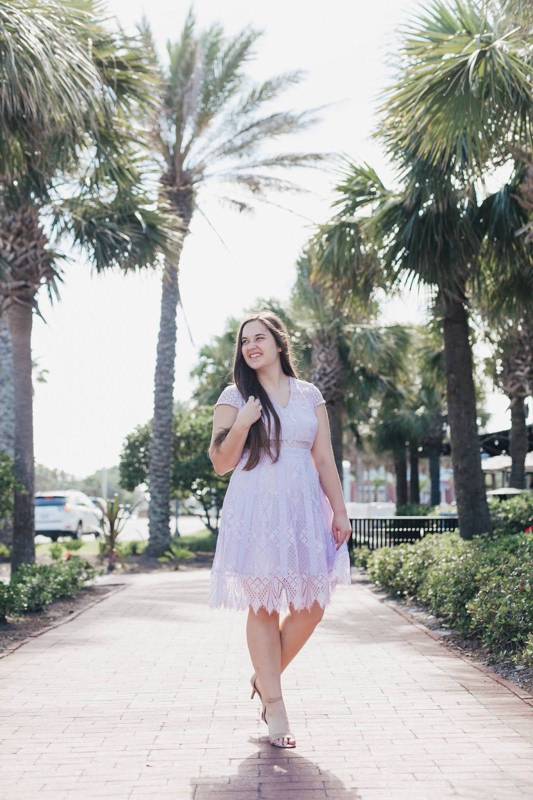 Girl wearing Lilac light purple lace fit and flare dress from Nordstrom with nude heels