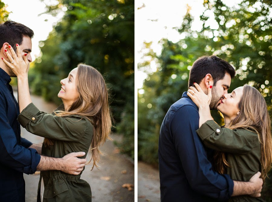 Silly candid engagement photos ,bokeh trees, kissing in Brooklyn Bridge Park showing engagement ring - www.cassiecastellaw.com