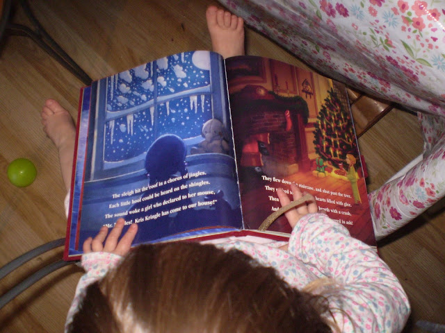 My eldest looking at the pages of the delightful book