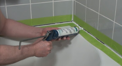 Laying a bead of sealant around the bottom of a tub & shower surround