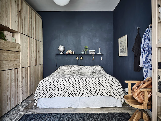 Bedroom With Dark Walls and Natural Wood 1
