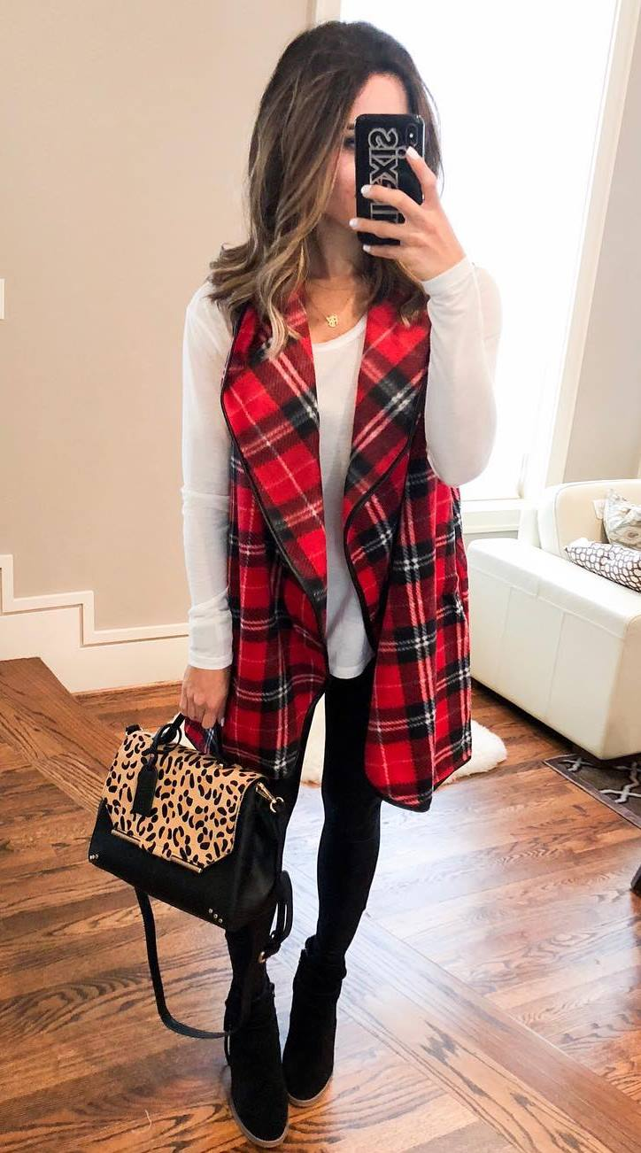 beautiful fall outfit / plaid vest + white top + black skinnies + boots + leopard boots