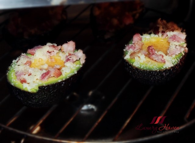baked avocado eggs with bacon bits