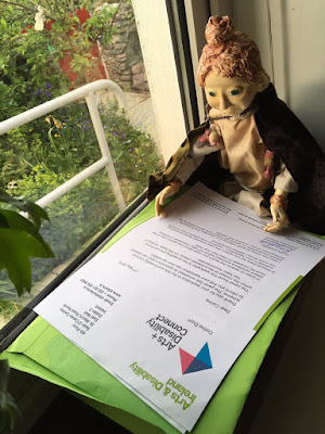 Póilin Puppet reading the Arts & Disability Ireland Connect  letter