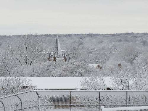 snow covered valley with church