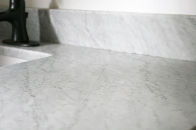A 1-Year Review of a Marble Vanity Top // How to Clean Marble // How to Protect Marble // Would I buy Marble Again? // Craftivity Designs