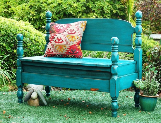 An upcycled bed frame and headboard made this garden bench
