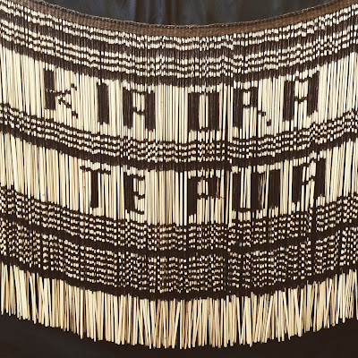 Maori grass skirt with the words 'Kia ora Te Puia' woven into it.