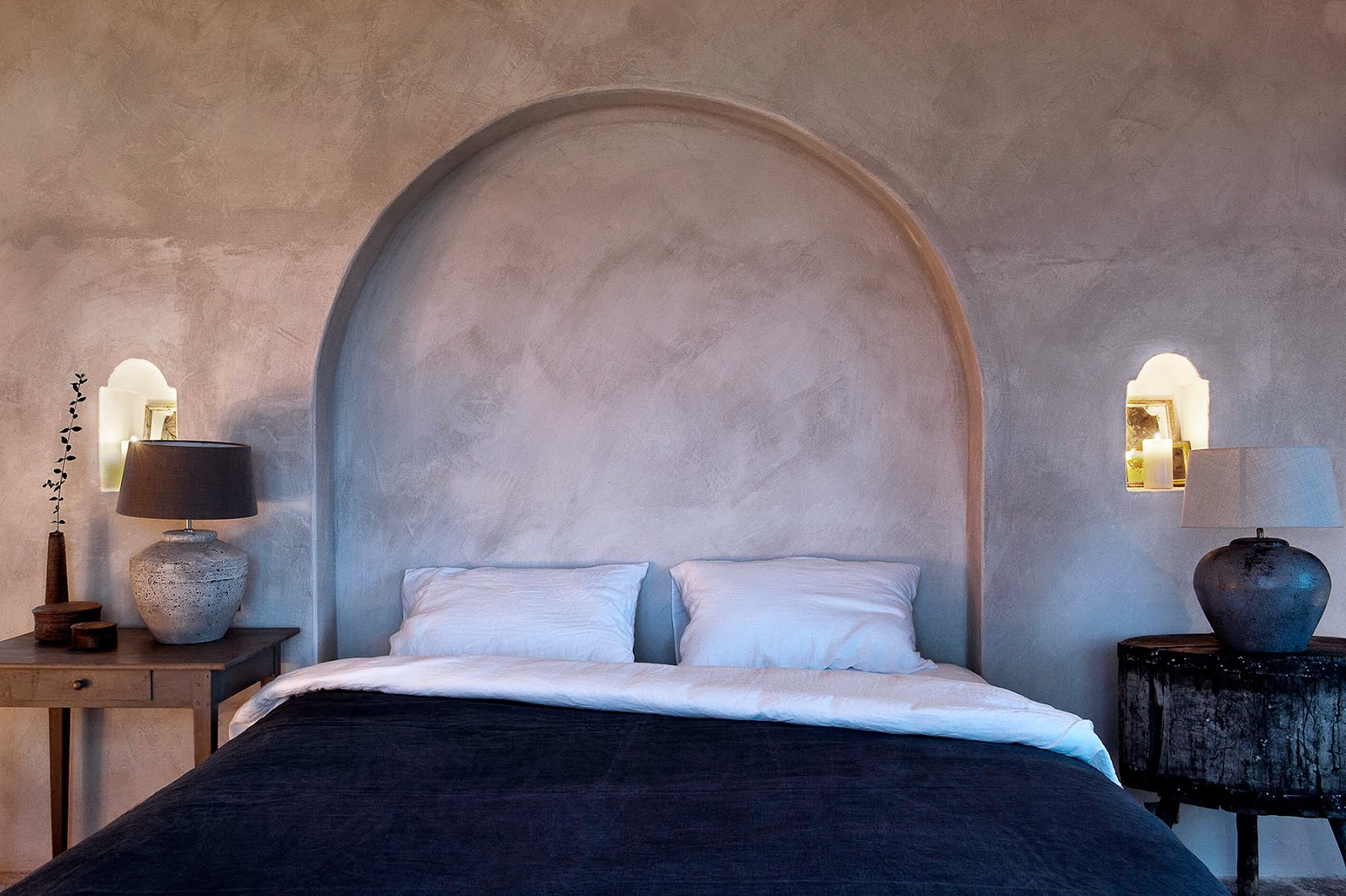 bedroom with arch as headboard