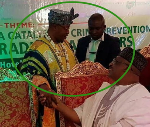 oluwo iwoland handshake seated politician