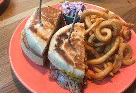 cuban sandwich bun with curly fries las iguanas