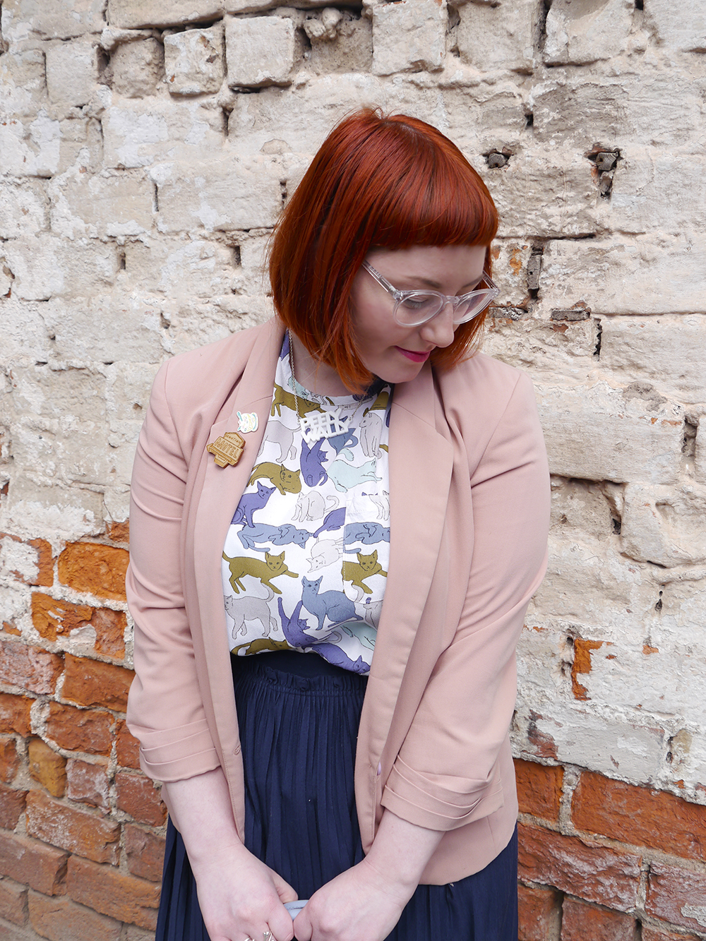 what Helen wore, red head, See with Iolla, Iolla clear glasses, clear spectacles, Scottish blogger, scottish fashion blogger, Dundee blogger, Dundee event, Dundee, cat lady, crazy cat lady outfit, cat top, H&M outfit, blue skirt, pleated navy skirt, charity shop shoes, white lace up boots, pink blazer, Lucky Dip Club pin, Kate Rowland wooden brooch, Bonnie Bling necklace, Scottish slang necklace, peely wally necklace, Scottish street style, brick wall background, cat print top