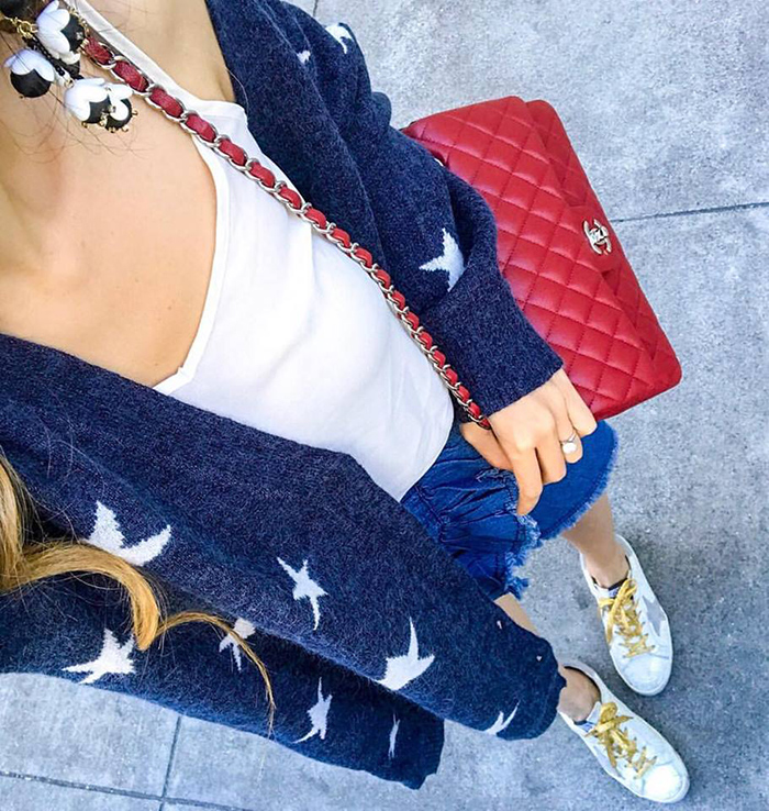 star cardigan, chanel classic flap bag, golden goose sneakers, ruffle skirt, baublebar earrings
