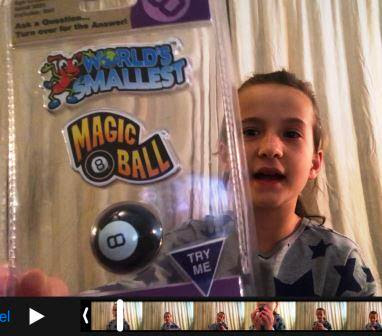 Girl with World's Smallest Magic 8 Ball in her hand