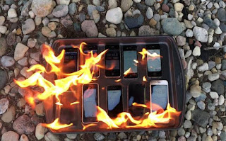 Watch: This Crazy Guy burnt 10 iPhone Models!