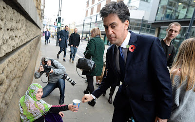Miliband and beggar
