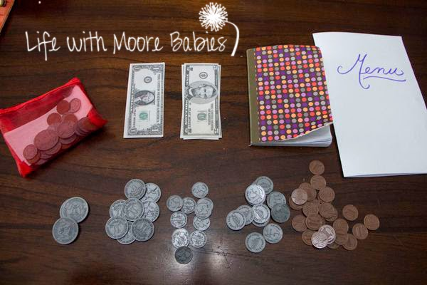 Play money makes this hands-on learning activity extra fun