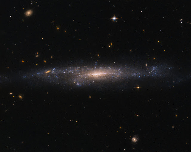 Hubble sees galaxy hiding in the night sky