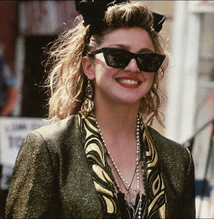 Madonna wearing Wayfarers and a headband in the 80s