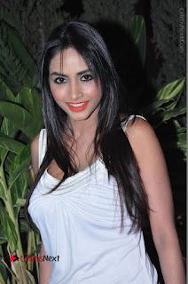 Actress Model Pooja Sri Stills in White Short Dress at F Club pre soft Launch  0059.JPG