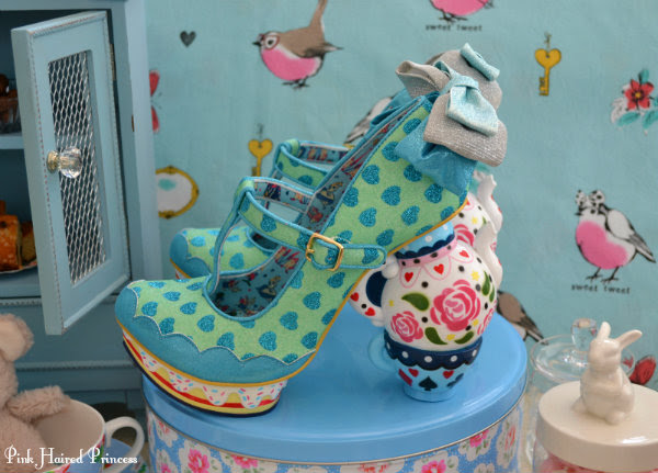 teapot and teacup heeled shoes in tea party setting