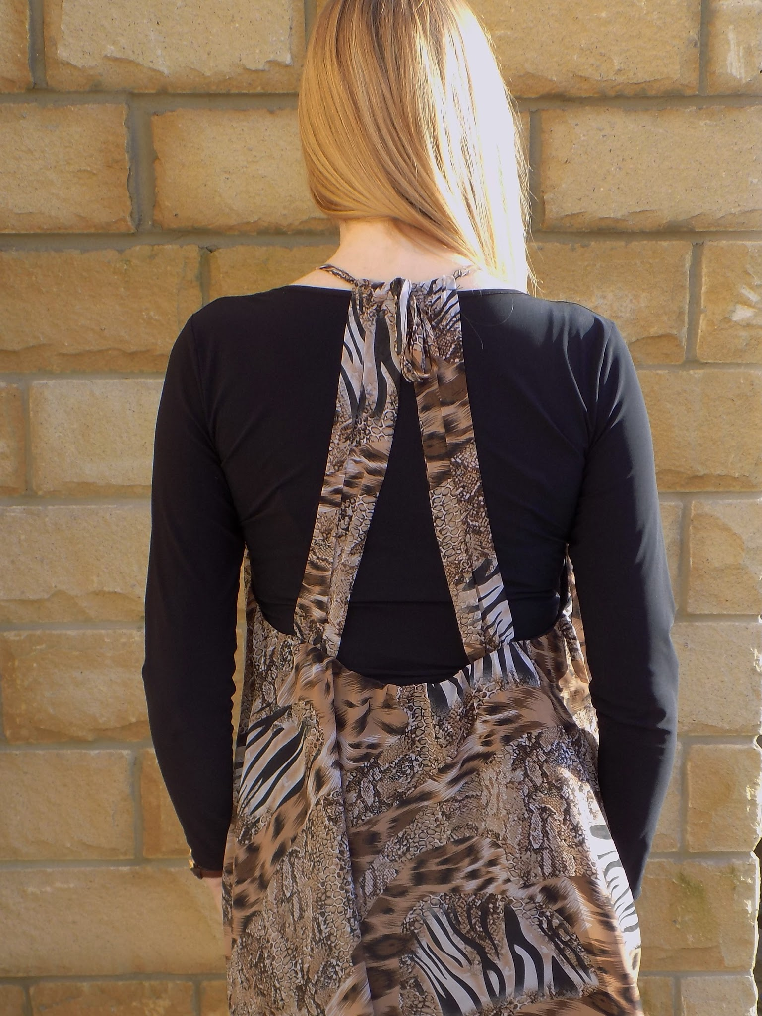 What Lizzy Loves wears animal print dress