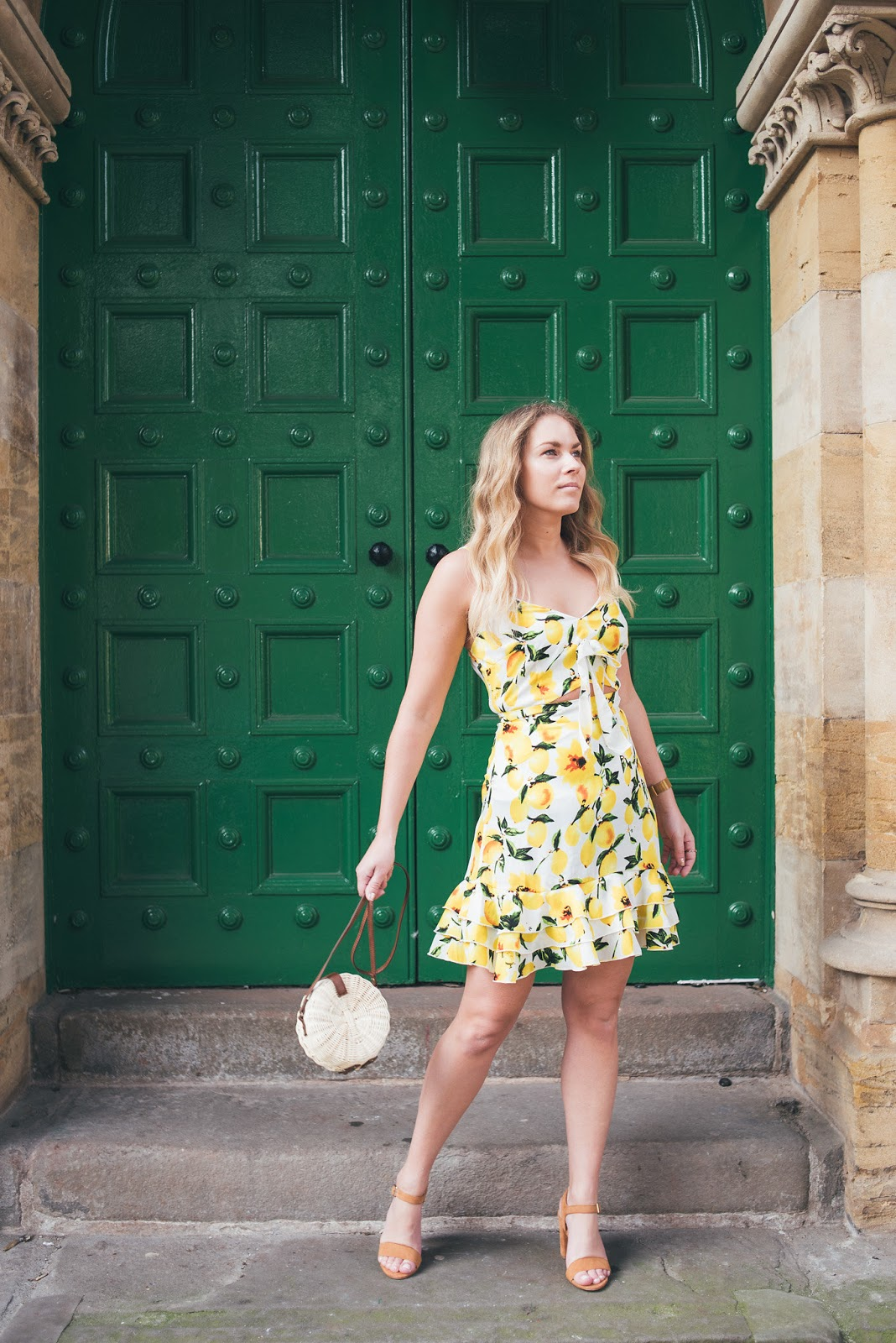 Rachel Emily in Lemon Dress swinging Pale round straw bag