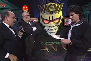WCW Halloween Havoc 1997 - JJ Dillon presents Eric Bischoff with the contract saying Hogan must wrestle
