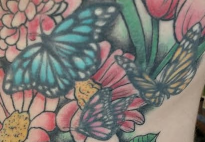 butterflies and flower tattoo closeup