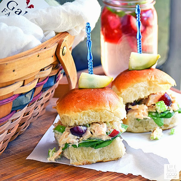 Chicken Salad Sliders   by Life Tastes Good combine a classic lunch sandwich favorite with the convenience of a slider bun. Freshly shredded chicken mixed with mayonnaise for creaminess, celery for a nice crunch, and a handful of refreshing grapes add a tasty sweetness. Perfect for lunch, dinner, or a fun picnic outing with the family!