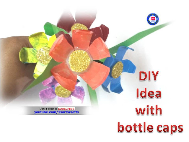 Here is plastic bottle crafts,plastic bottle caps crafts,how to make water bottle caps flowers,plastic bottle caps projects,kids crafts with recycled materials,plastic bottle caps ideas,how to make arts crafts with water bottle caps,diy idea with bottle caps crafts,art&craft ideas,how to make plastic water bottle caps flowers for home decoration