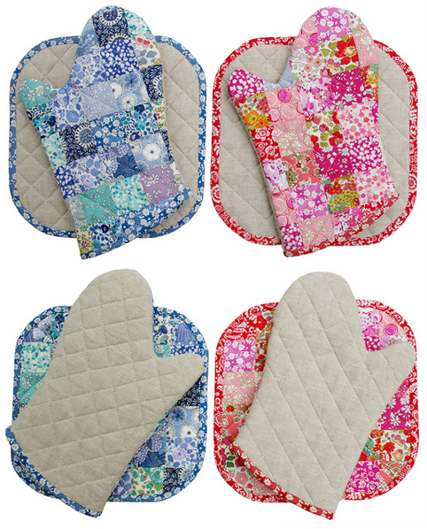 Two Sets Of Oven Mitts And Potholders