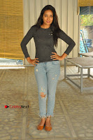 Actress Bhanu Tripathri Pos in Ripped Jeans at Iddari Madhya 18 Movie Pressmeet  0055.JPG
