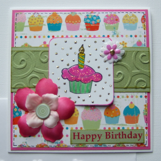 Handmade cupcake card design with stamped motif, glaze, glitter and in greens and pinks